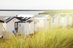 Dutch beach houses with warm sun effect Royalty Free Stock Photos