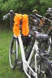 Dutch bike with orange garlands, FIFA WC football Stock Images