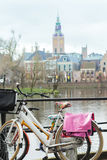 Dutch bikes with floral pattern saddle covers at Court Pond and Grote of Sint-Jacobskerk background Royalty Free Stock Image