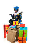 Dutch black pete with many presents Stock Images