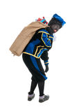 Dutch black pete with many presents in jute bag Royalty Free Stock Photos