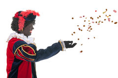Dutch black pete throwing Sinterklaas candy Stock Photo