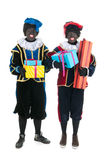 Dutch black petes with presents Royalty Free Stock Photography