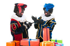 Dutch black petes with presents Royalty Free Stock Photos