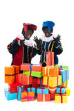 Dutch black petes with presents Stock Photography