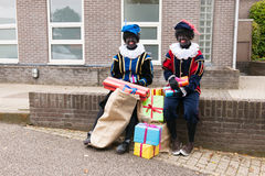 Dutch black Petes with presents Stock Photos