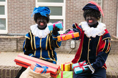 Dutch black Petes with presents Royalty Free Stock Photo