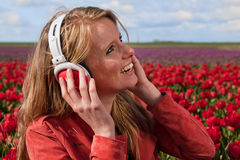 Dutch blond girl with headphones Stock Images