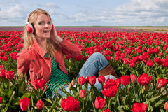 Dutch blond girl with headphones Royalty Free Stock Photography