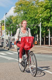 Dutch blond girl on her bicycle, Amsterdam, Netherlands Royalty Free Stock Photography