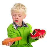 Dutch boy with shoe Stock Image