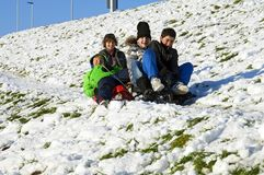 Dutch boys sledding in the snow on a hill royalty free stock image