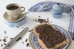Dutch breakfast with bread and chocolate hail hagelslag, cup of tea royalty free stock images