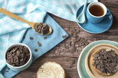 Dutch breakfast with rusk and chocolate flakes, blue mug with tea stock photos