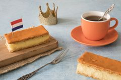 Orange tompouce, trditional Dutch treat with pudding and frosting on national holiday Kings Day April 27th, in The Netherlands. royalty free stock photography