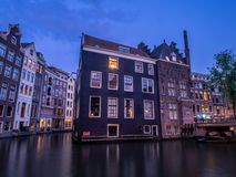 Dutch canal buildings in Amsterdam royalty free stock image