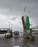 Dutch canal and open drawbridge Stock Image