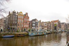 Dutch canals and typical canalside houses Royalty Free Stock Photos