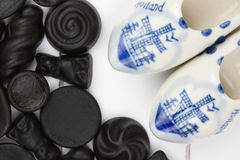 Dutch candy called dropjes with miniature wooden shoes Stock Images