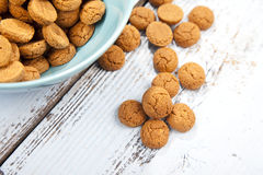 Dutch candy pepernoot with bowl on wooden background Royalty Free Stock Photo