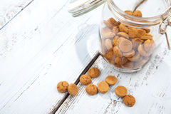 Dutch candy pepernoot with glass jar and wooden background Stock Photos