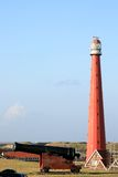 Dutch canon and lighthouse near Huisduinen Stock Photo