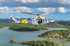 The Dutch Caribbean Coastguard helicopter over Groot St martha Royalty Free Stock Photos
