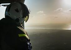 The Dutch Caribbean Coastguard - winchman in the sunset Royalty Free Stock Photo