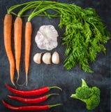 Dutch carrots, garlic, chilli peppers, broccoli. Top view. Stock Photos