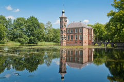 Dutch Castle Bouvigne in Breda, North Brabant. The Dutch Castle Bouvigne reflected in the water surface of the pond Stock Images