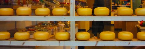 Dutch cheese forms on show in the windows of amsterdam tourist shops. enogastronomic product typical of the Netherlands. Dutch cheese forms on show in the stock photo