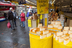 Dutch cheese on the market in Veenendaal. Cheese and people on the market in the dutch town of Veenendaal royalty free stock photography
