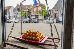 Traditional cheeses in old scales in the village of edam. netherlands royalty free stock photography