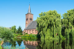 Dutch church at a river in summer Stock Photography