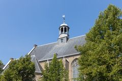 Dutch church with roof against a blue sky Royalty Free Stock Photo
