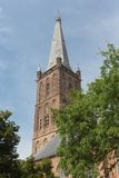 Dutch church tower against a blue sky Royalty Free Stock Photos