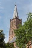 Dutch church tower against a blue sky royalty free stock photos