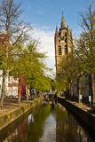 Dutch city of Delft with its canals and Old Church (Oude Kerk) Stock Image
