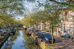 Dutch city Enkhuizen with cars parked along a canal Royalty Free Stock Image