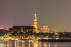 The Dutch city of Nijmegen with the flooded river Waal in front. During the evening stock photos
