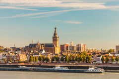 The Dutch city of Nijmegen during sunset. With the river Waal in front Royalty Free Stock Images