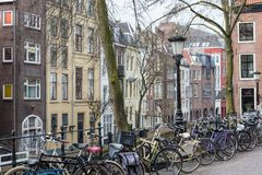 Dutch city with bicycles and old historic houses Royalty Free Stock Photography