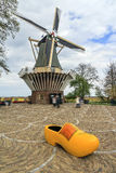 Dutch clog and windmill Royalty Free Stock Images