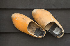 Dutch Clogs on the wooden wall. Stock Photo
