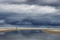 Dutch clouds with fishing boat Stock Images