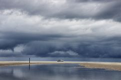 Dutch clouds with fishing boat Royalty Free Stock Image