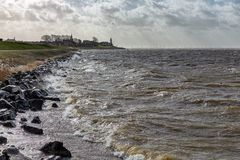 Dutch coast with backlight view at skyline village Urk stock photo