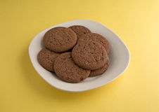 Dutch Cocoa Soft Cookies On Plate Yellow Background Stock Photos
