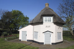 Dutch Cottage Museum on Canvey Island, Essex, England, against a Stock Image