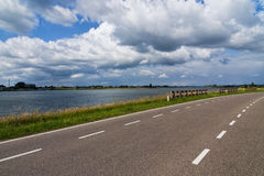 Dutch country road under the cloudy sky stock images